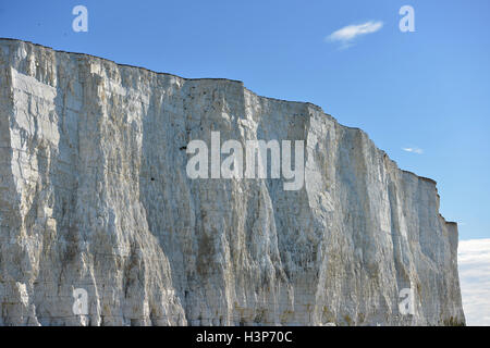White chalk cliffs near Beachy Head, Eastbourne and rock pools - Stock Photo