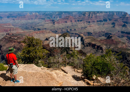 Tourists at the rim of the Grand Canyon in Arizona - Stock Photo