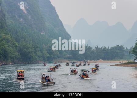 Many Bamboo Rafts on the Li river in the haze near Yangshuo, China - Stock Photo