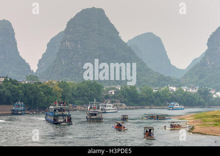 Tourist Boats traffic in cloudy weather on the Li River, Yangshuo - Stock Photo