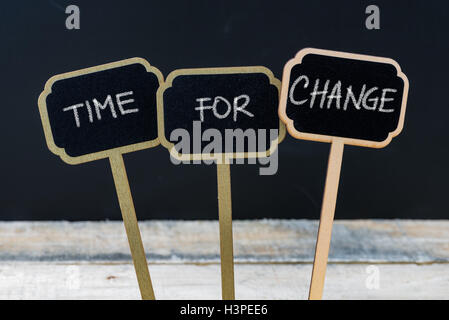 Business message TIME FOR CHANGE written with chalk on wooden mini blackboard labels - Stock Photo