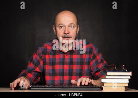 Carefully look for information on the Internet. Study of computer use in the elderly - Stock Photo