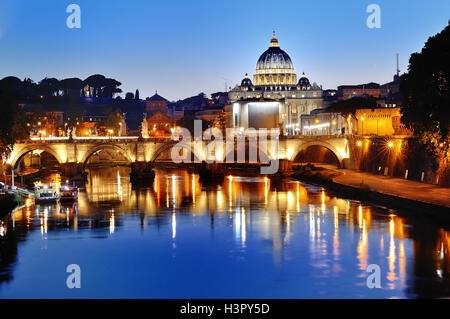 Rome, Italy - scenic view of the Tiber river and St. Peter's Basilica at night - Stock Photo