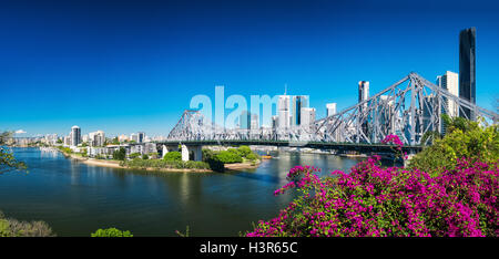 BRISBANE, AUS - AUGUST 9 2016: Panoramic view of Brisbane Skyline with Story Bridge and the river. It is Australias - Stock Photo