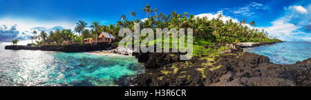 Panoramic view of coral reef and palm trees on south side of Upolu, Samoa Islands. - Stock Photo