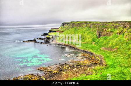 Rugged coastline of Ireland island near Ballintoy - Stock Photo
