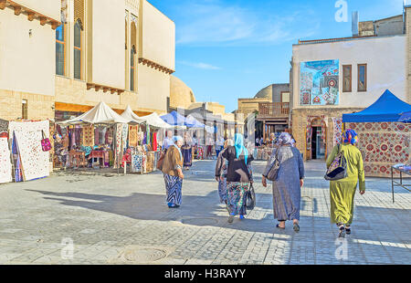 The streets of the old town are often used as the market places in Bukhara. - Stock Photo