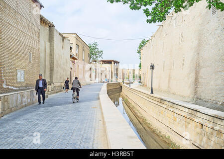 The narrow street in the center of the old town in Bukhara. - Stock Photo