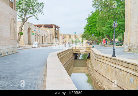 The daily walk in the old town in Bukhara. - Stock Photo