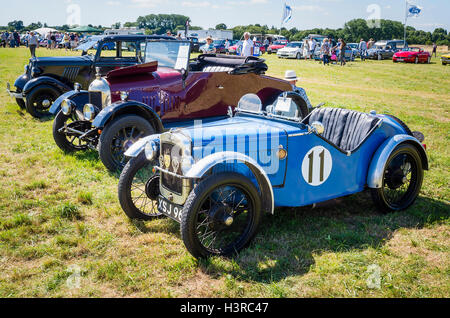 A line-up of old cars at a country show including an Austin 7 from the 1930s - Stock Photo