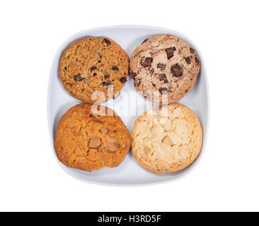 Variety of cookies in ceramic plate isolated on white - Stock Photo