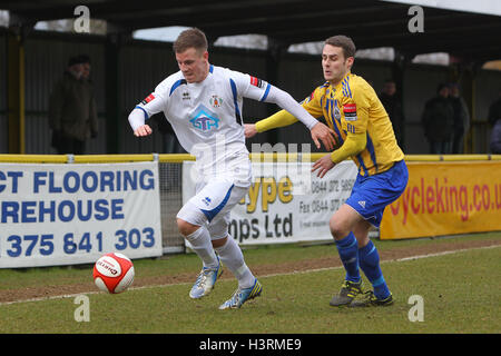 Jack West of Grays seeks to evade Paul Clayton of Romford - Romford vs Grays Athletic - Ryman League Division One - Stock Photo