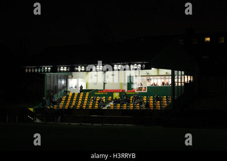 The lights in the stand glow in the gloom during a floodlight failure - Thurrock vs AFC Hornchurch - Robert Dyas - Stock Photo