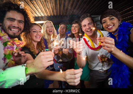 Group of friends having fun in bar - Stock Photo