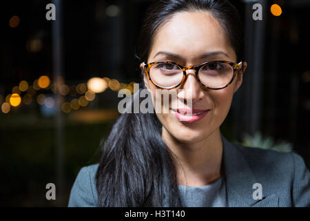 Portrait of businesswoman in spectacle - Stock Photo