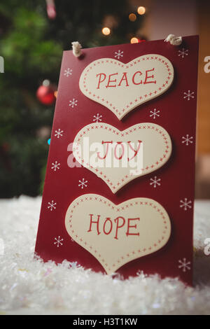 Christmas label with massages of peace, joy and hope - Stock Photo
