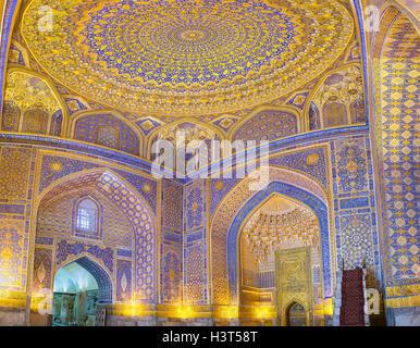 The mosque interior of Tilya Kori Madrasah in Samarkand. - Stock Photo