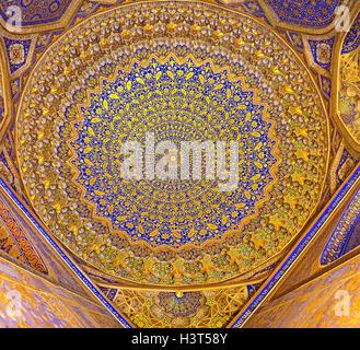 The cupola of mosque in Tilya Kori Madrasah is the masterpiece of the Uzbek art in Samarkand. - Stock Photo
