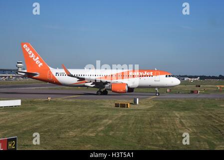 London Gatwick Airport Crawley Surrey Easyjet Airbus A320 aircraft  ready for takeoff - Stock Photo