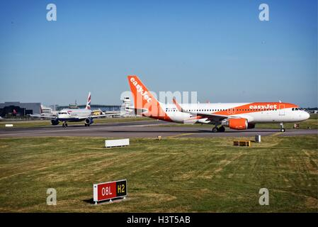 London Gatwick Airport Crawley Surrey Easyjet and British Airways  Airbus A320's taxi for takeoff - Stock Photo