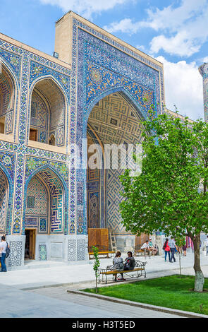 The richly decorated portal of the courtyard in Ulugh Beg Madrasah in Samarkand. - Stock Photo