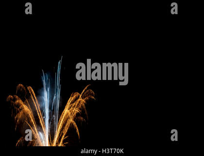 Elegant gold & white fireworks night sky black background New Years Eve New Year's Day Fourth of July Independence - Stock Photo
