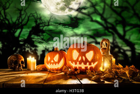 Scary halloween pumpkins on wooden planks. Empty space for text - Stock Photo