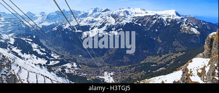 The view on Wengen–Mannlichen aerial cableway and Lauterbrunnen Valley  from the mountain top, Switzerland. - Stock Photo