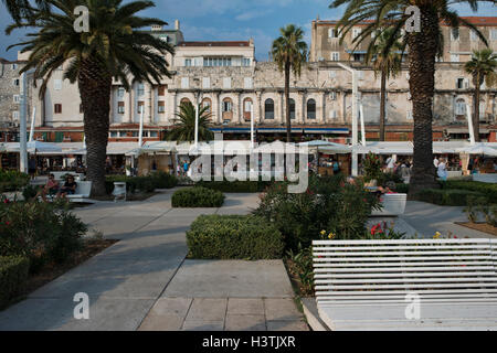 View on the Riva waterfront promenade in front of the southern facade of the Diocletian's Palace. Split, Split-Dalmatia - Stock Photo