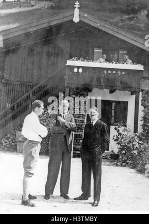 ADOLF HITLER at right with Rudolf Hess at left in discussions at the Berghof about 1938. Man in glasses not identified. - Stock Photo