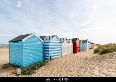 Coastal sightseeing out of season: Colourful beach huts on the seashore at Blackshore Harbour, Southwold, Waveney - Stock Photo