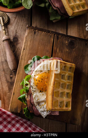 Waffles sandwich with eggs and lettuce, old style sandwich - Stock Photo