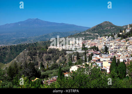 The hilltop city of Taormina with Mount Etna, Sicily, Italy - Stock Photo