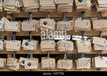 Wooden ema wish plaques at Meiji Jingu Shrine, Tokyo, Japan - Stock Photo