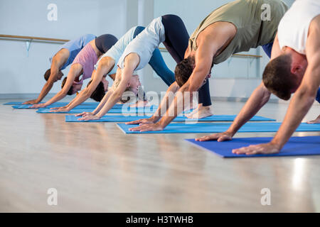 Group of people performing yoga - Stock Photo
