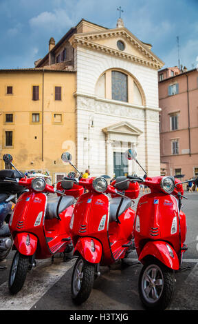 Three Vespa scooters at Piazza di San Pantaleo in Rome, Italy - Stock Photo