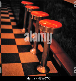 1930s 1940s STYLE COUNTER STOOLS IN NYC DINER - Stock Photo