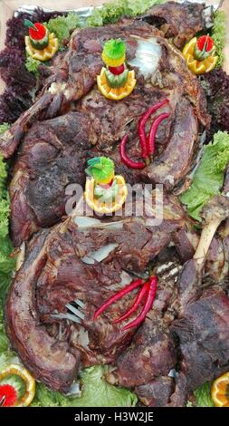 Marinated Lamb Roasted in Brick Oven - Stock Photo
