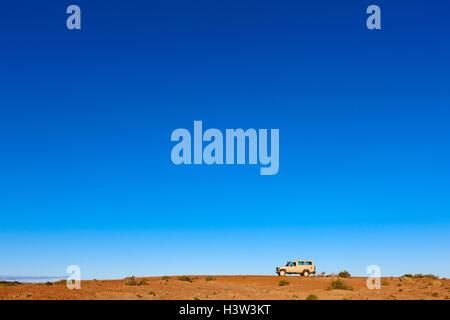4WD vehicle in vast outback landscape, near Lake Eyre, South Australia. - Stock Photo