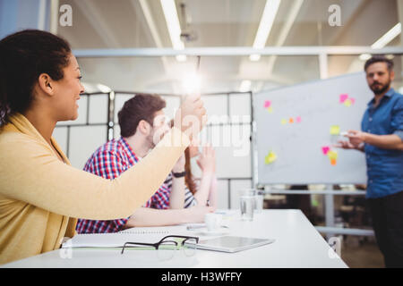 Colleagues in board room during brainstorming session at creative office - Stock Photo