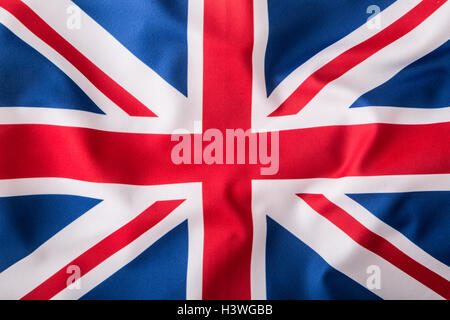 Closeup of Union Jack flag. UK Flag. British Union Jack flag blowing in the wind. - Stock Photo