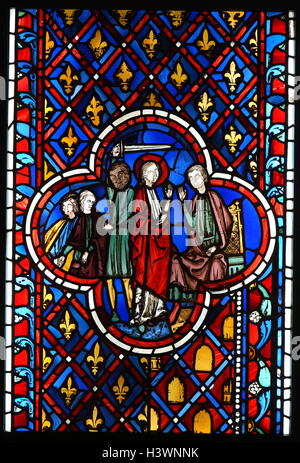 Stained glass from The Sainte-Chapelle in Paris - Stock Photo