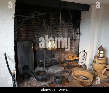 Elizabethan kitchen with fireplace and pots - Stock Photo