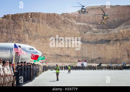 Amman, Amman, Jordan. 19th Apr, 2015. International teams line up while helicopters hover overhead during the opening - Stock Photo