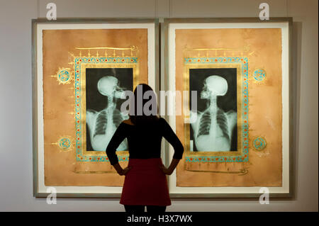 London, UK.  13 October 2016. A Sotheby's staff member views 'Illumination XIX & XX, 2005' by Ahmed Mater (est. - Stock Photo