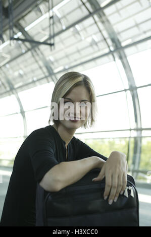Airport, hall, woman, sit, wait, smile alone, go away airport terminal, waiting room, travellers, 20-30 years, young, - Stock Photo