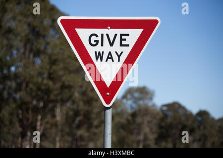 Give Way Sign, Give way or yield to oncoming traffic. - Stock Photo