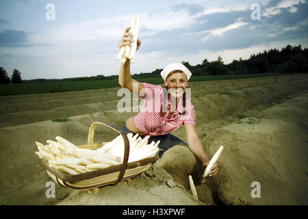 Asparagus field, woman, young, asparagus, harvest field, asparagus cultivation, agriculture, country living, vegetables, - Stock Photo