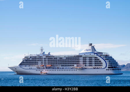 Visiting ocean cruise liner ship Seven Seas Voyager at sea anchored offshore in a fjord in summer. Nuuk (Godthab), - Stock Photo