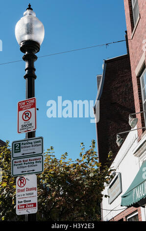 Classic style street light and warning signs on a lamp post in downtown Boston, MA, USA. - Stock Photo